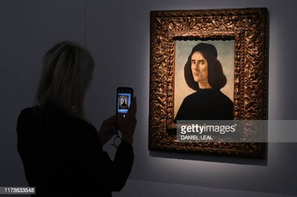 A visitor takes a photograph of the portrait of soldier and poet of Renaissance Florence Michele Marullo which is billed as the Last Botticelli and...