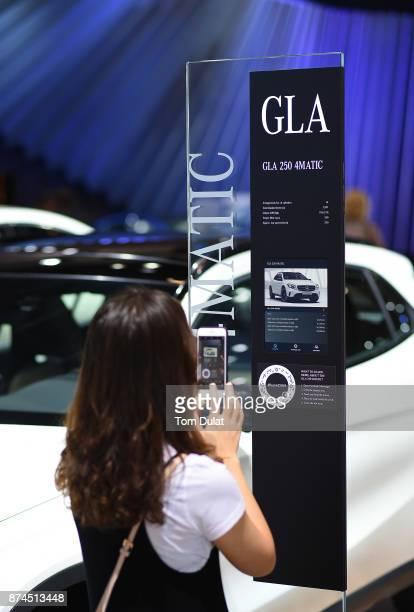 A visitor takes a picture during Dubai Motor Show at Dubai World Trade Centre on November 15 2017 in Dubai United Arab Emirates