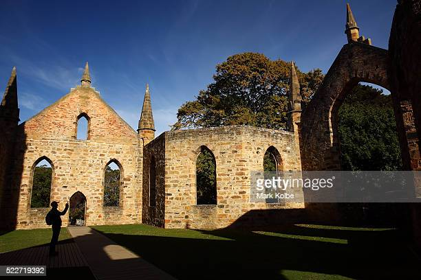 A visitor takes a picture in the church at the Port Arthur Historical Site is seen on April 18 2016 in Port Arthur Australia The historic town became...