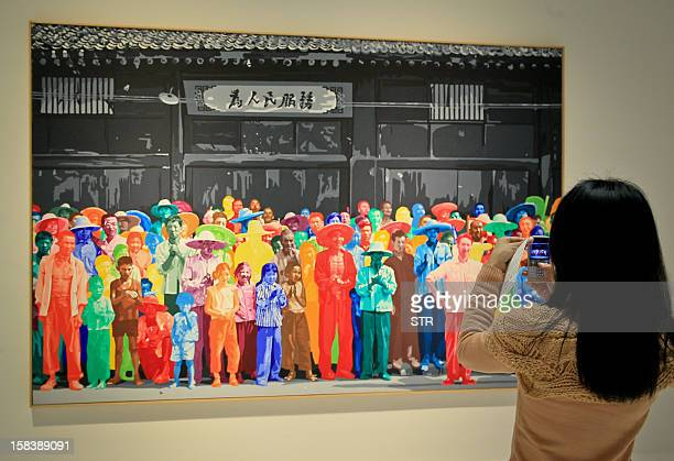 A visitor takes a picture of an exhibit provided by Centre Pompidou a leading French museum of modern and contemporary art at the Shanghai China Art...