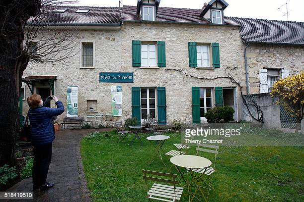 A visitor takes a picture of the absinthe museum on March 31 2016 in AuverssurOise France Absinthe was the favorite drink of the painter Vincent Van...