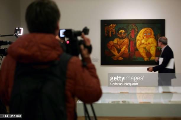"Visitor takes a picture of the artwork 'Paradis Lost' during the preview of the exhibition ""Emil Nolde - Eine deutsche Legende. Der Kuenstler im..."