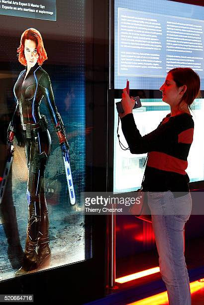 A visitor takes a picture of the character of Black Widow played by actress Scarlett Johasson during the Marvel Avengers STATION exhibition at La...