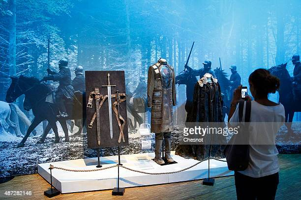 A visitor takes a picture of the costumes of the serie 'Game of Thrones' during the opening of an exhibition dedicated to HBO's television medieval...