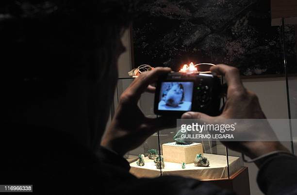 A visitor takes a picture of the largest emerald in the world called 'Fura' of 11000karat raw and 227 kilos during the 'Minergemas 2011' exhibition...