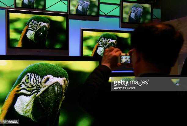 Visitor takes a picture of the LCD flat screen at CeBIT on March 9, 2006 in Hanover, Germany. The world's largest computer and information technology...