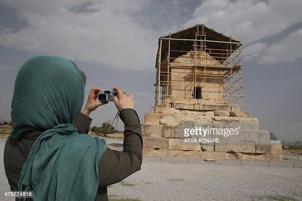 A visitor takes a picture of the limestone tomb of ancient Persia's King Cyrus the Great who founded the Achaemenid empire in the 6th century BC in...