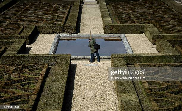 A visitor takes a picture on February 20 2013 in the gardens of the Apostolic Palace of Castel Gandolfo Italy Pope Benedict XVI will stay at the...