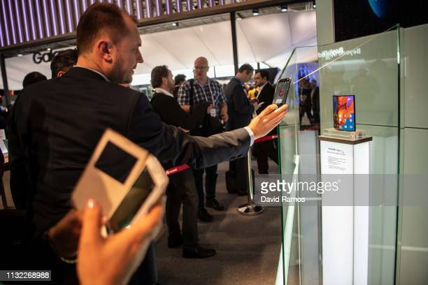A visitor takes a picture to new Huawei Mate X at the Huawei booth on day 2 of the GSMA Mobile World Congress 2019 on February 26 2019 in Barcelona...