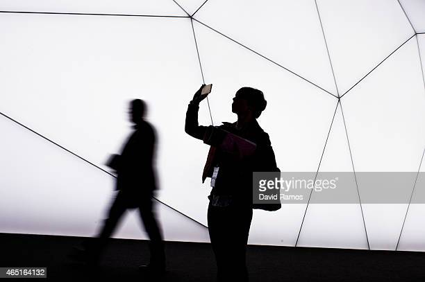 Visitor takes a picture with her phone during the second day of the Mobile World Congress 2015 at the Fira Gran Via complex on March 3, 2015 in...