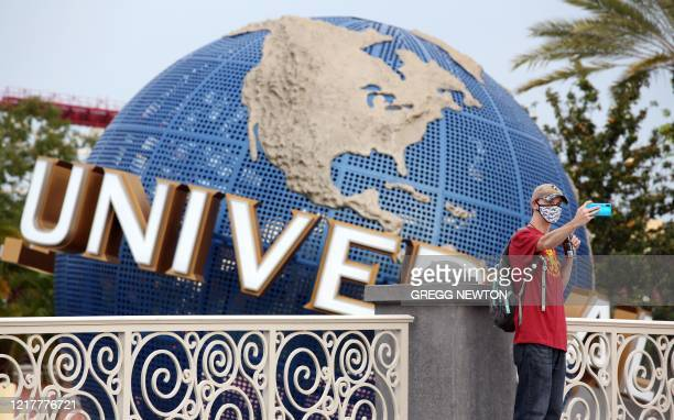 A visitor takes a selfie at Universal Studios theme park on the first day of reopening from the coronavirus pandemic on June 5 in Orlando Florida