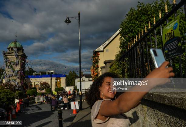 Visitor takes a selfie inside the village of Enniskerry in County Wicklow. There are only two more days until filming begins for Disney's...