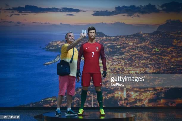 A visitor takes a selfie with a Cristiano Ronaldo waxwork inside the CR7 Museum located in Funchal seafront on the island of Madeira where Portuguese...