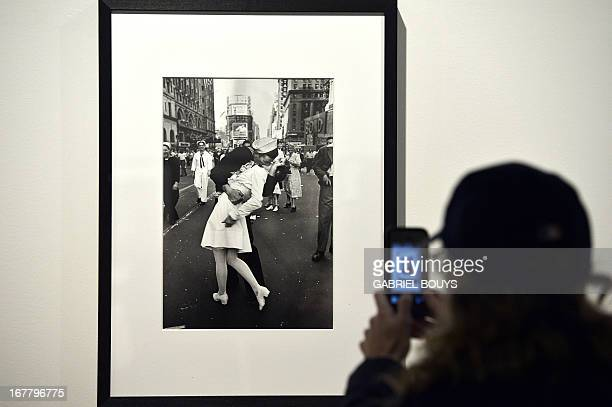 A visitor takes a snapshot of 'VJ Day a Times Square New York NY 1945' by Alfred Eisenstaedt during the 'Life I grandi fotografi' exhibition at the...