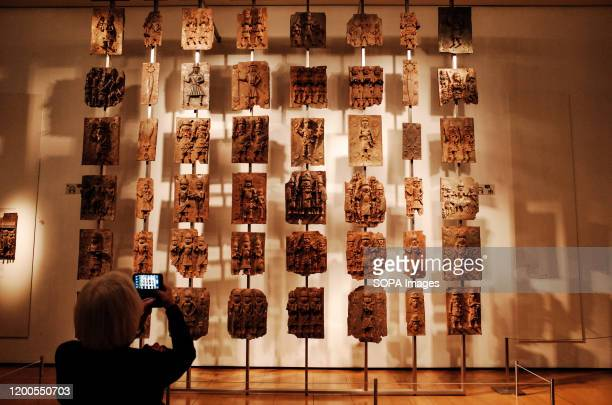Visitor takes photos of the contentious Benin plaques exhibit at the British Museum in London. The museum, one of London's top tourist attractions,...