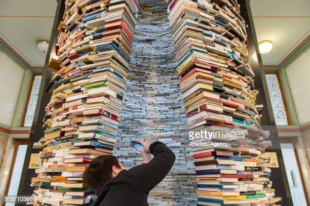 Visitor takes photos of the inside of Idiom installation, created by Slovakian artist, Matej Kren, is seen at Prague Library in Prague, Czech...