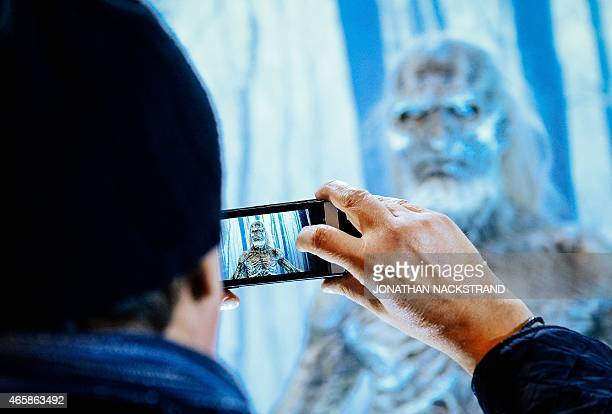 Visitor takes pictures of a model of the White Walker character from the HBO American fantasy drama television series Game of Thrones at the...