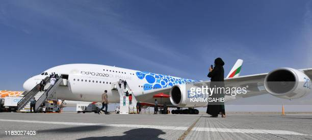 Visitor takes pictures of an Emirates Airlines' Airbus A380 displayed at the Dubai airshow in the United Arab Emirates on November 17, 2019.