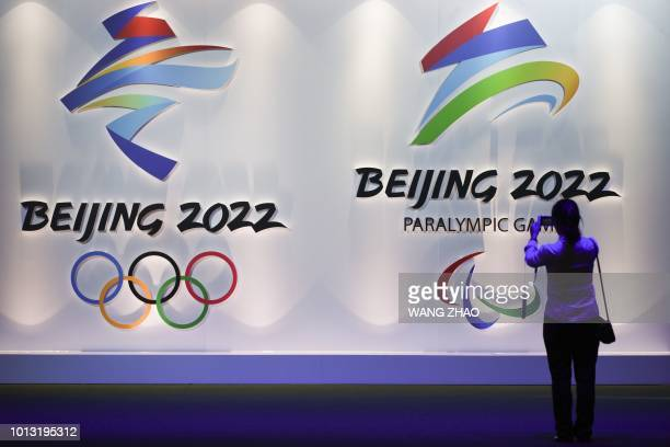 Visitor takes pictures of logos of the upcoming Beijing 2022 Winter Olympic and Paralympic Games during the Beijing Olympic Expo marking the 10th...