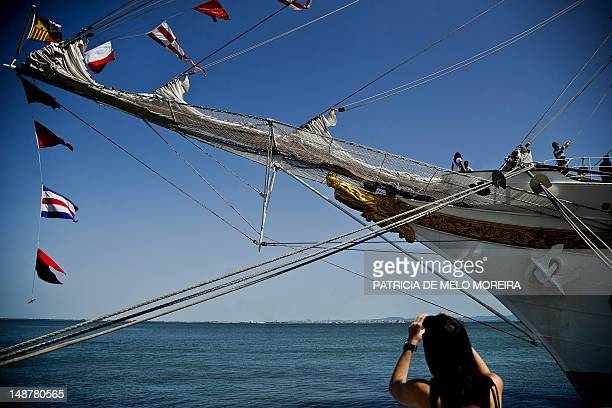 A visitor takes pictures of the Spanish tall ship Juan Sebastian De Elcano in Lisbon on July 19 during the Tall Ships' races 2012 an international...