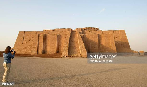 A visitor takes pictures of the stepped Ziggurat temple a threetiered edifice dating back to 2113 BC in the ancient city of Ur in southern Iraq on...