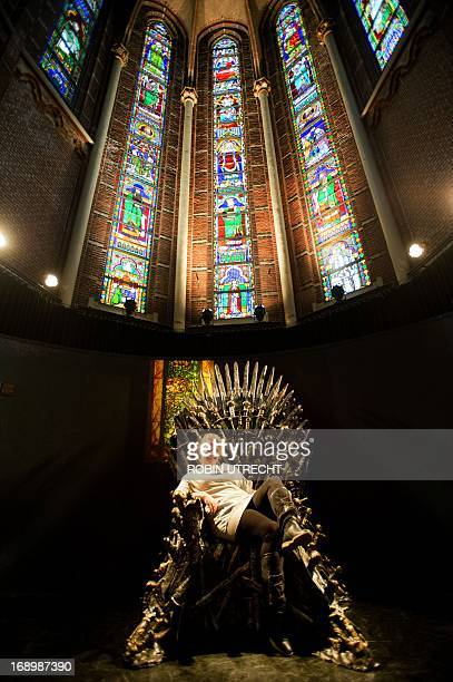 A visitor takes place in the Iron Throne of the Game of Thrones during a exhibition about the US tv seriesGame of Thrones in the Posthoornkerk in...