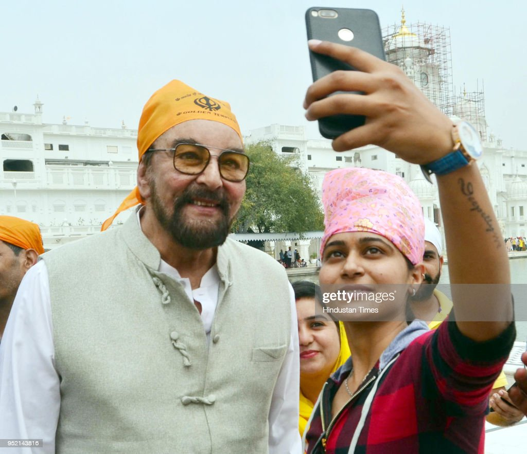 Visitor taking selfie with Bollywood actor Kabir Bedi at Golden Temple on April 27 2018 in Amritsar India