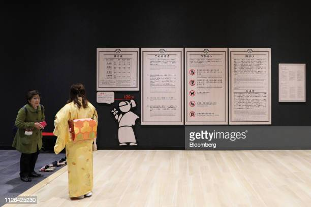 Visitor talks to an employee at the Solaniwa Onsen spa at Osaka Bay Tower in Osaka, Japan, on Thursday, Feb. 21, 2019. Fortress Investment Group, a...