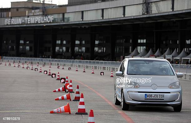 Visitor test drives an electric Volkswagen e-up! automobile at the Electric Mobility Week , a public Volkswagen event at the former Tempelhof...