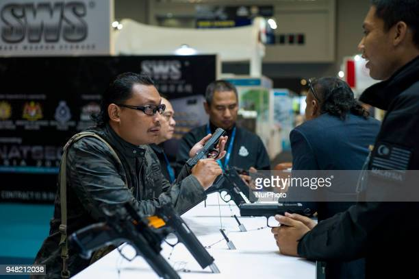 A visitor testing a CZ's Pistol of Czech Republic during the 16th Defence Services Asia 2018 exhibition at MITEC in Kuala Lumpur Malaysia on April 18...