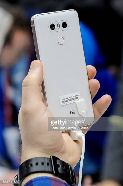 Visitor testing the new LG G6 during the LG G6 launch during the Mobile World Congress, on February 26, 2017 in Barcelona, Spain.