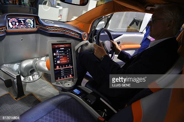 A visitor tests a car with internet connection on the third day of the Mobile World Congress in Barcelona on February 24 2016 The world's biggest...