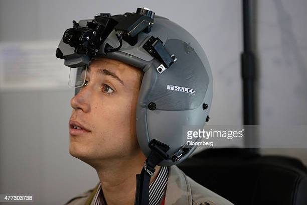 A visitor tests a Scorpion full color Helmet Mounted Display system manufactured by Thales SA on display on day two of the 51st International Paris...