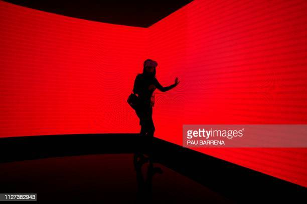 A visitor tests a virtual reality headset at the Saudi Telecom Company at the Mobile World Congress in Barcelona on February 25 2019 Phone makers...