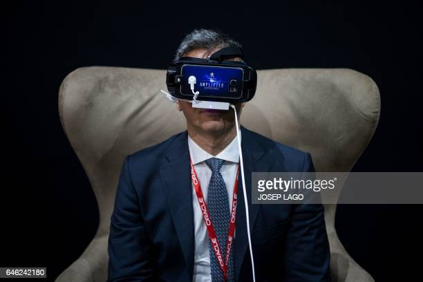 A visitor tests an 'amplified experience' device at the vehicle manufacturer Peugeot stand on the second day of the Mobile World Congress on February...