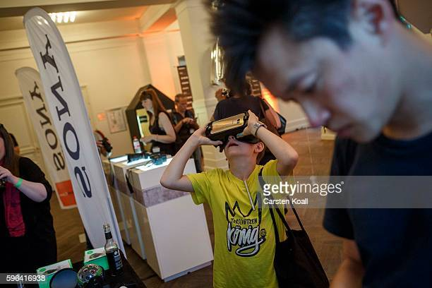 A visitor tests the 360 view on the Getty Images stand during the EyeEm photofestival at Heimathafen Neukoelln on August 27 2016 in Berlin Germany