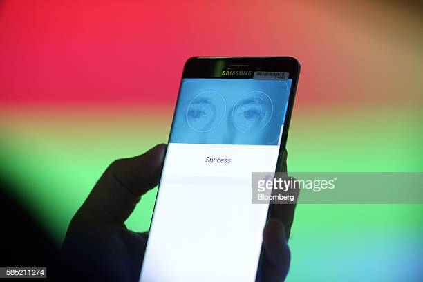 A visitor tests the iris scanning security capability on the Galaxy Note 7 smartphone during a Samsung Electronics Co 'Unpacked' launch event in...