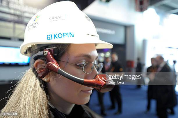 A visitor tests the new Motorola GoldenI device at the Mobile World Congress in Barcelona Spain on Tuesday Feb 16 2010 Leading mobile executives from...