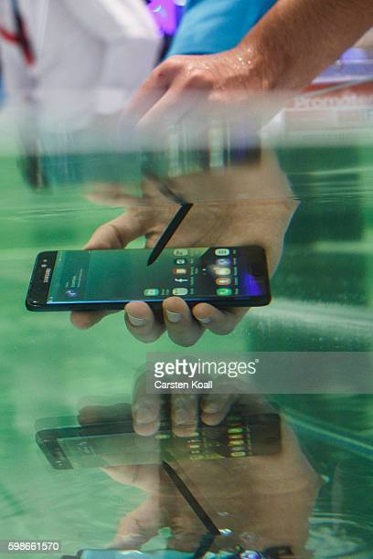 A visitor tests the waterproof S7 from Samsung at the 2016 IFA consumer electronics trade fair on September 2 2016 in Berlin Germany IFA is among the...