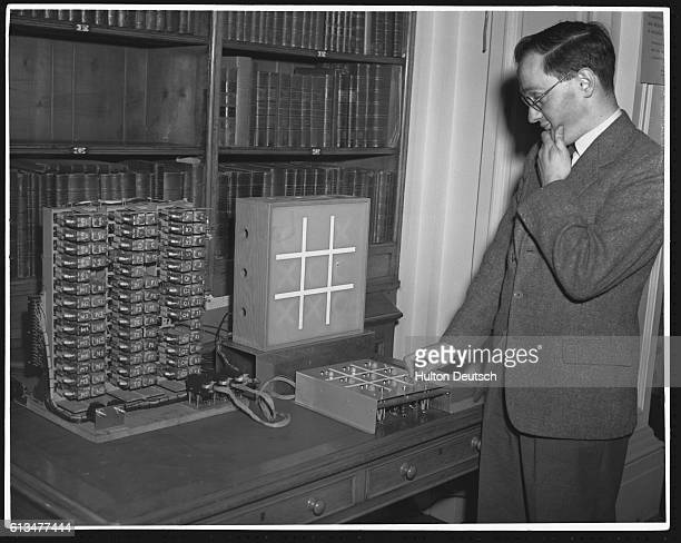 A visitor to a conference held by the Royal Society at Burlington House to promote interest in scientific research experiments with an electronic...