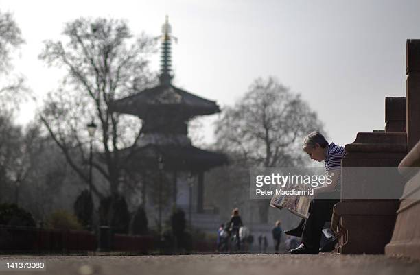 A visitor to Battersea Park enjoys the spring sunshine on March 15 2012 in London England Parts of the United Kingdom are enjoying the warmest day of...
