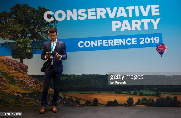 Visitor to conference takes a break during the second day of the Conservative Party Conference at Manchester Central on September 30, 2019 in...