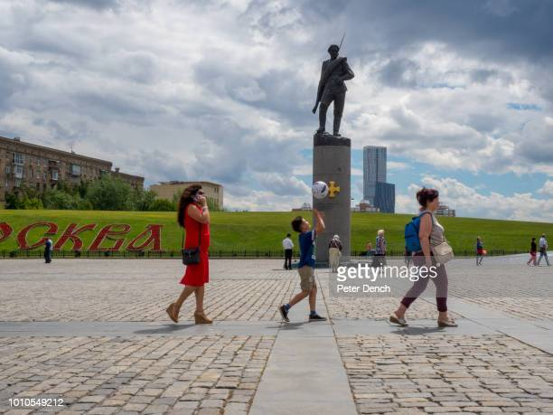 A visitor to Poklonnaya Hill plays with a football one of Moscow's highest points it's home to the Victory Park with World War II displays and a war...