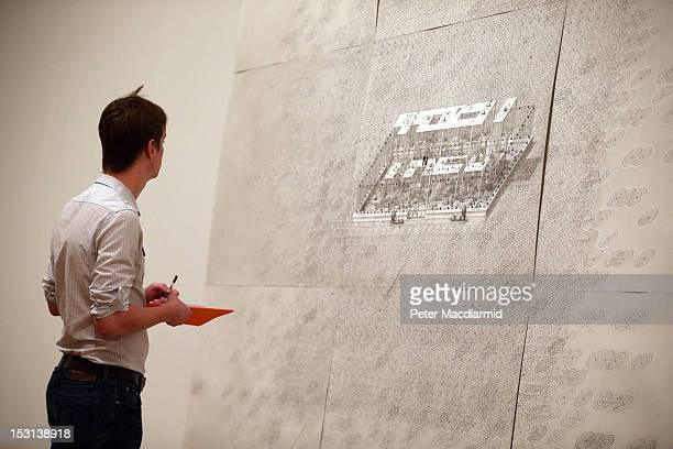 A visitor to Tate Britain looks at Turner Prize nominee Paul Noble's ' TREV 2012' drawing on October 1 2012 in London England The GBP£25000 Turner...