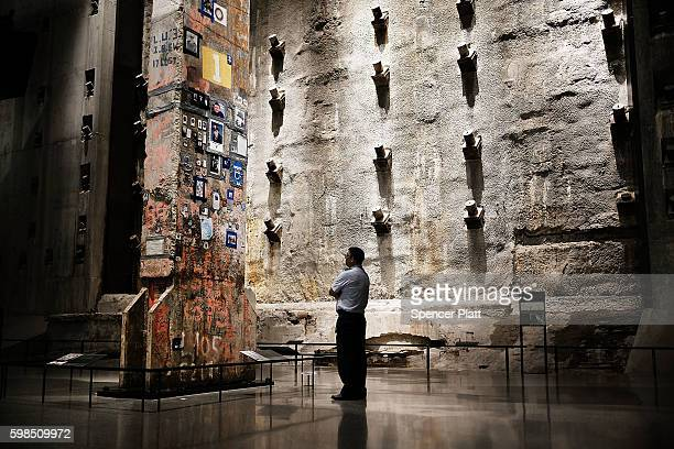 A visitor to the 9/11 Memorial Museum looks up at the last foundation pillar that was standing from the World Trde Center site on September 01 2016...