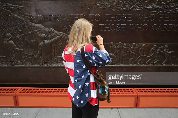 A visitor to the 9/11 Memorial takes photos on September 10 2013 in New York City Tomorrow marks the 12th anniversary of the attacks of September 11...