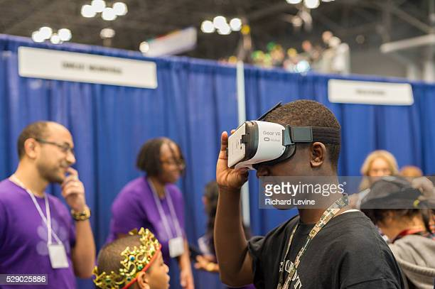Visitor to the Comcast NBCUniversal booth wears a Samsung Gear VR Virtual reality device at a Career Expo held at the FIRST Robotics NYC Championship...