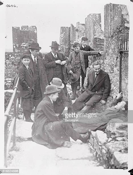 A visitor to the famous Blarney Castle outside of the City of Cork kissing the Blarney Stone famed for it's supposed wonder working powers The photo...