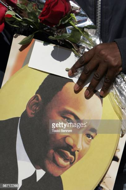 Visitor to the King Center holds a picture of Dr. Martin Luther King Jr. And flowers following the death of his widow Coretta Scott King January 31,...