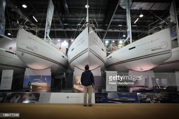 Visitor to The London Boat Show at The ExCel Centre looks up at a line of boats on January 6, 2012 in London, England. The 58th Boat Show opens today...